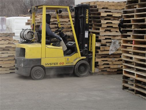 Picture of our fork lift driver moving pallets around the yard.
